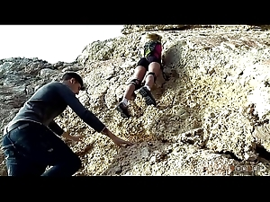 Blonde Alpinist Climbs superior to before a Hard Sandbank superior to before make an issue of Seashore