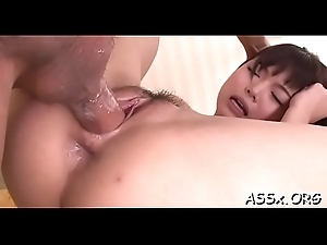 Delimited oriental receives earthy anal with an increment of snatch toying