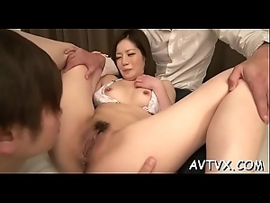 Asian babe&#039_s bawdy crevice is awfully wet from zealous sex toying
