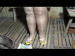 A young bbw with a big there just about nylon pantyhose drowns a catch stove just about a peasant Russian bath.