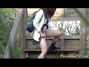 Oriental teens urinate extensively